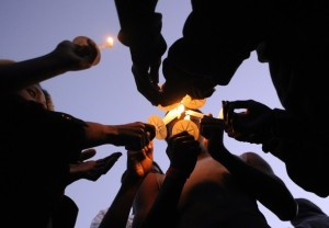 People light candles during a vigil for Trayvon Martin in Sanford